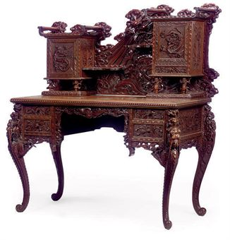 A SOUTH EAST ASIAN CARVED HARDWOOD DESK