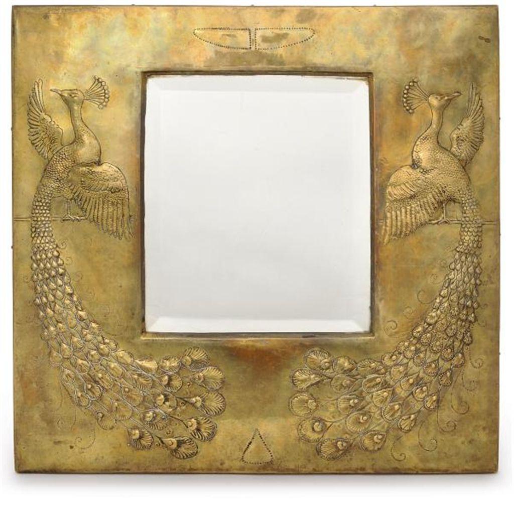 AN ARTS & CRAFTS BRASS WALL MIRROR
