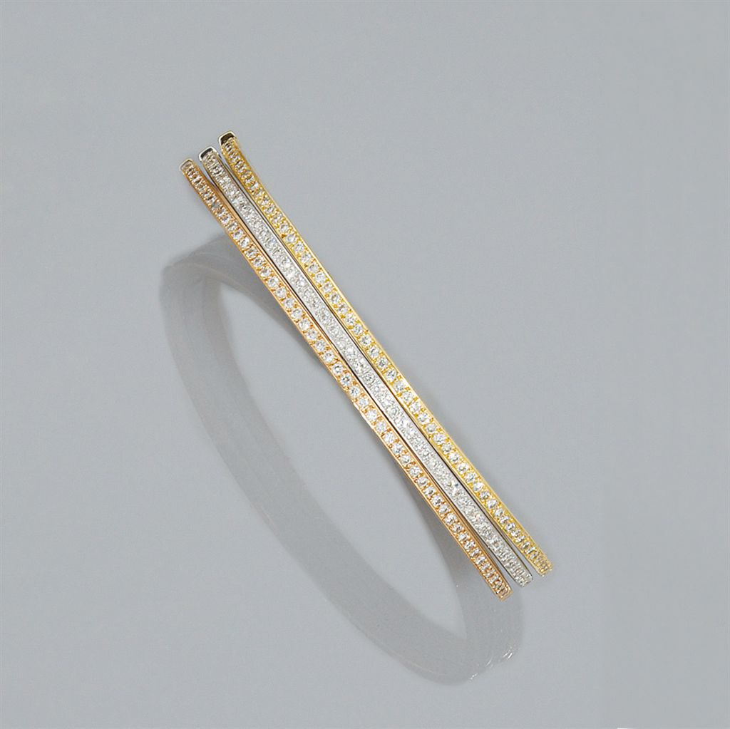 A set of three diamond set three colour bangles