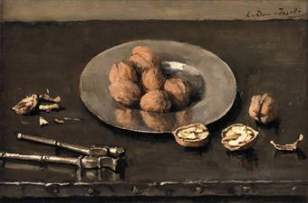 A still life with walnuts on a pewter plate