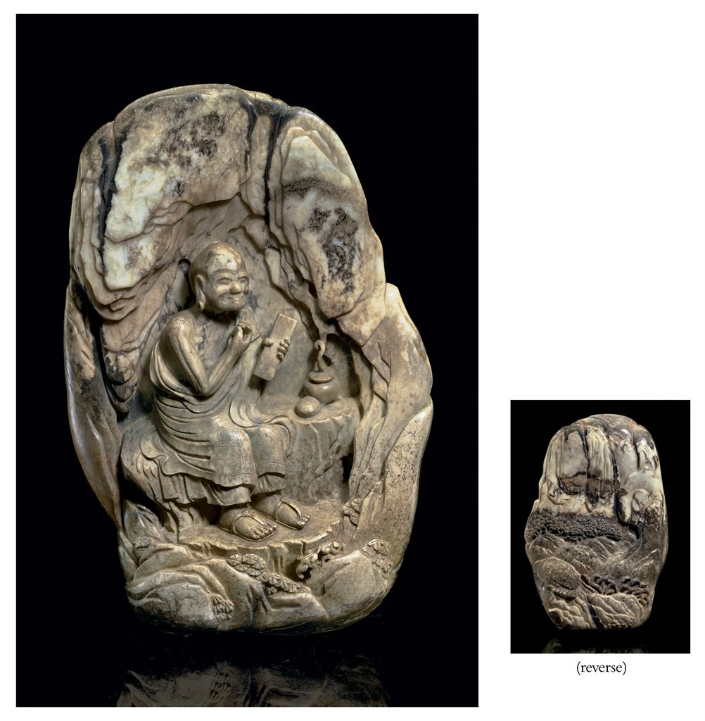 A LARGE MOTTLED GREYISH-WHITE AND BLACK OPAQUE JADE GROTTO ...