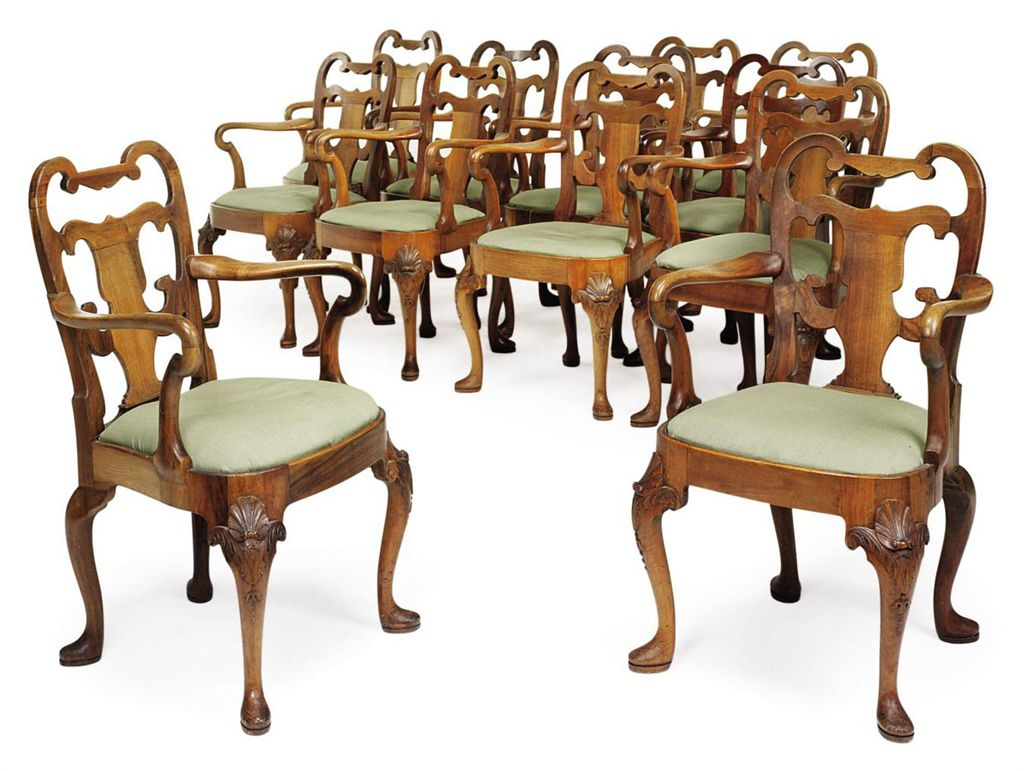 A SET OF TWELVE WALNUT CARVED OPEN ARMCHAIRS