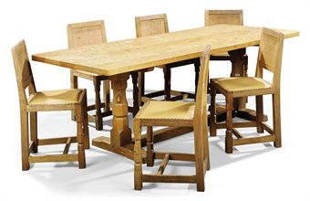 A ROBERT THOMPSON MOUSEMAN OAK DINING TABLE AND SIX