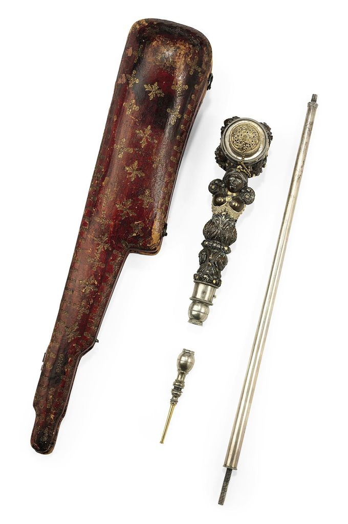 AN UNUSUAL CARVED PIPE WITH SILVER AND GILT-METAL MOUNTS