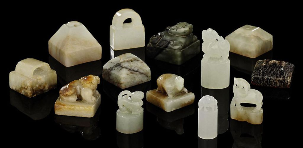 A SMALL COLLECTION OF THIRTEEN SMALL JADE SEALS