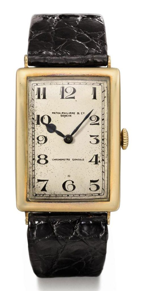 Patek Philippe A large and rare rectangular curved wristwatc...