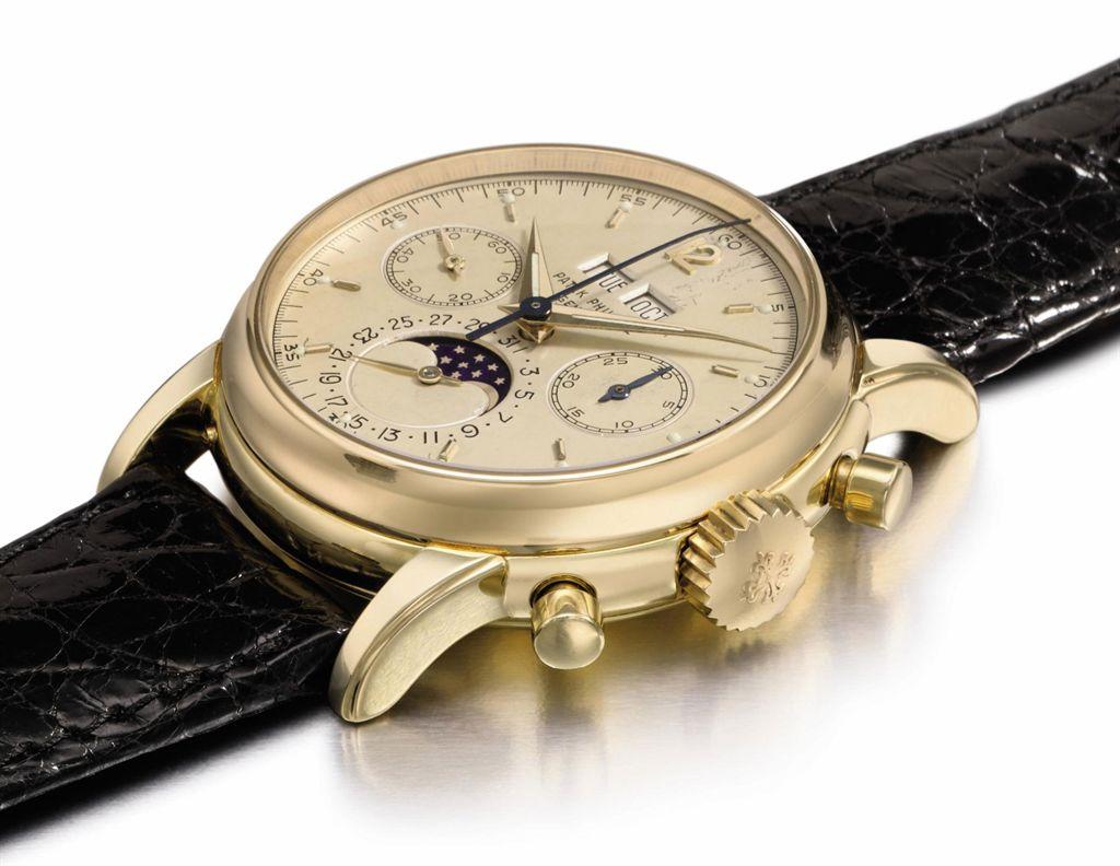 Patek Philippe A very fine and rare 18K gold perpetual calen...
