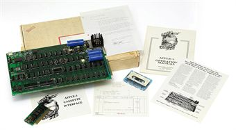 APPLE-1 -- Personal Computer. An Apple-1 motherboard, number 82, printed label to reverse, with a few slightly later additions including a 6502 microprocessor, labeled R6502P  R6502-11  8145, printed circuit board with 4 rows A-D and columns 1-18, three capacitors, heatsink, cassette board connector, 8K bytes of RAM, keyboard interface, firmware in PROMS, low-profile sockets on all integrated circuits, video terminal, breadboard area with slightly later connector, with later soldering, wires and electrical tape to reverse, printed to obverse Apple Computer 1  Palo Alto. Ca. Copyright 1976.