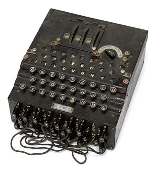 'ENIGMA' -- Cipher Machine. A three-rotor Enigma machine, number A-9457, with electric core, three aluminium rotors each stamped WaA618, raised 'QWERTZ' keyboard with crackle black painted metal case (some restoration), three division window flap over rotors and plugboard in the front with ten patch leads, with metal label 'Chiffriermaschinen Gesellschaft Heimsoeth und Rinke, Berlin W.35 Ludendorffstraße 6' on the inside of the lid, circa 1939. Modern power supply. 260 x 320 x 140mm.