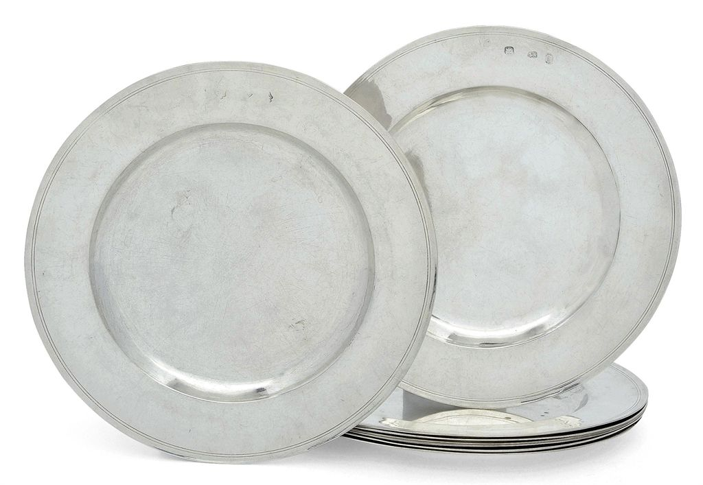 A SET OF EIGHT JAMES II SILVER DINNER-PLATES