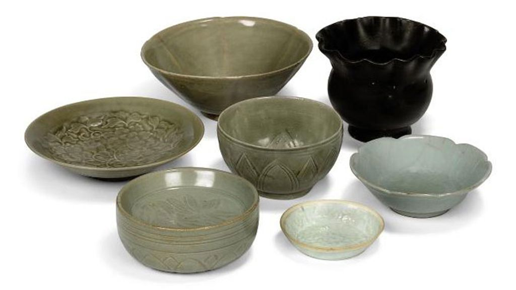 A CHINESE BROWN GLAZED BOWL AND A FURTHER SIX BOWLS