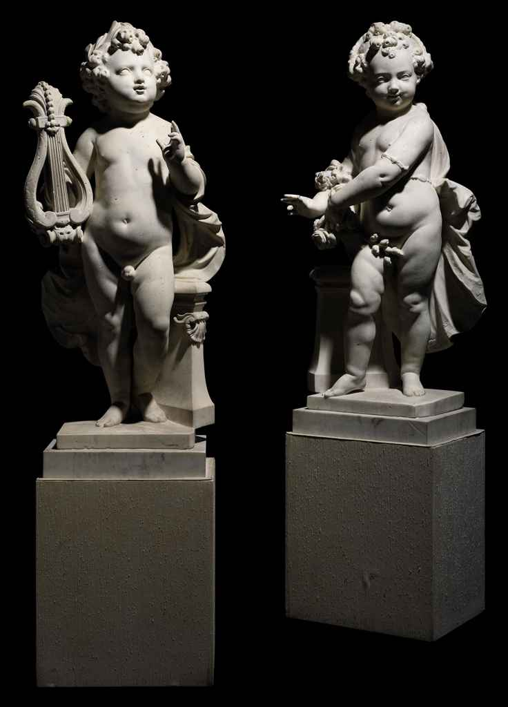 A PAIR OF CARVED MARBLE ALLEGORICAL FIGURES OF A BOY AND GIR...