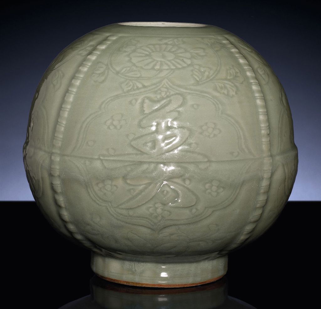A VERY RARE EARLY MING LONGQUAN CELADON CARVED JAR