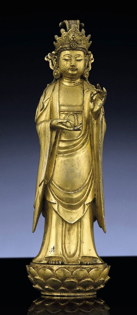 AN IMPORTANT AND VERY RARE GILT-BRONZE FIGURE OF AVALOKITESV...