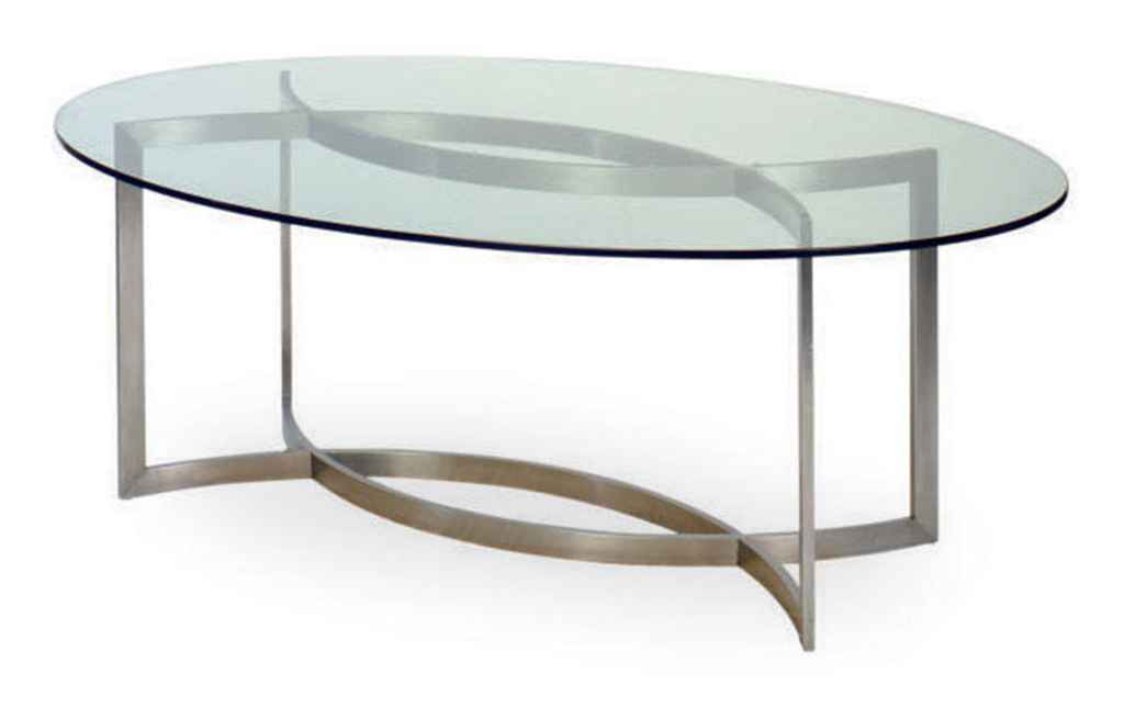 A CHROMEDMETAL AND GLASS OVAL DINING TABLE DESIGNED BY PAUL - Glass oval dining table