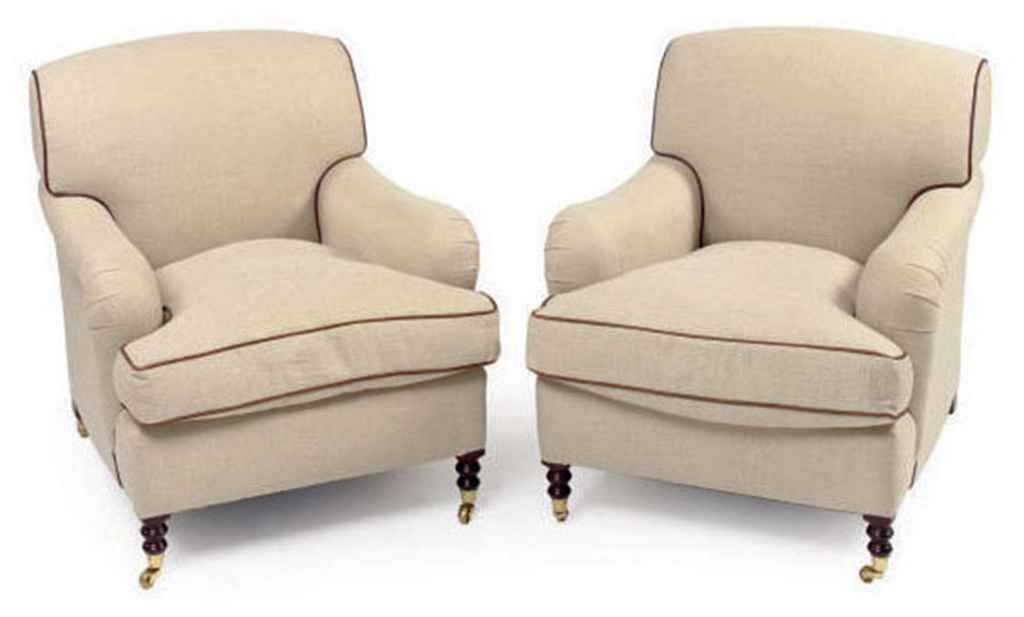 A PAIR OF LEATHER TRIMMED CREAM TWILL UPHOLSTERED CLUB