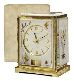A SWISS GILT-BRASS AND PLEXIGASS ATMOS MARINA CLOCK