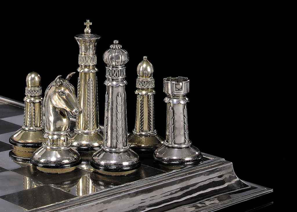 An Art Deco German Silver And Silver Gilt Chess Set And