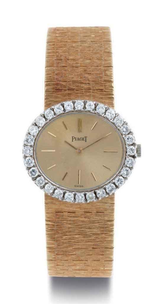 PIAGET A LADY'S 18K GOLD AND DIAMOND WRISTWATCH WITH BRACEL...