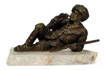 A RUSSIAN BRONZE FIGURE OF A COSSACK HUNTSMAN