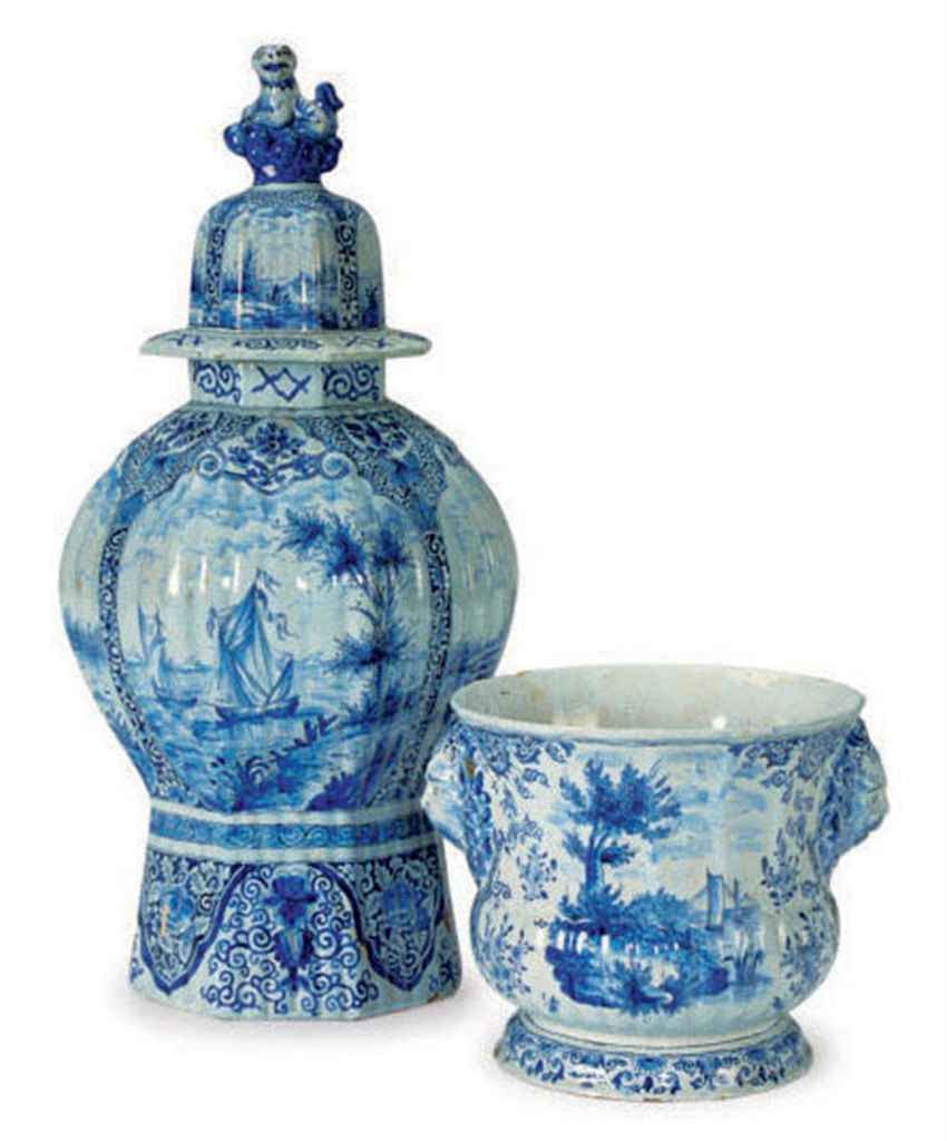 A DUTCH DELFT BLUE AND WHITE RIBBED BALUSTER VASE AND COVER ...