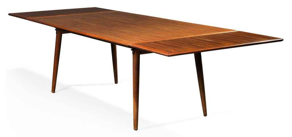 a hans wegner teak extending dining room table made by