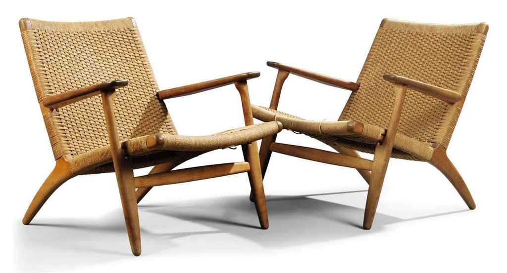 A PAIR OF HANS WEGNER OAK AND RUSH SEATED LOUNGE CHAIRS MADE BY