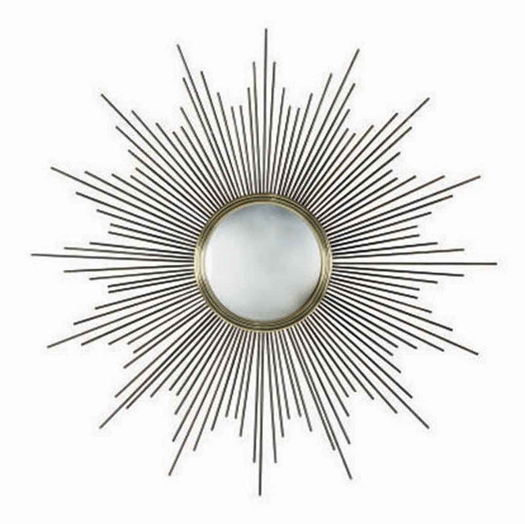 A GILT AND PATINATED METAL SUN