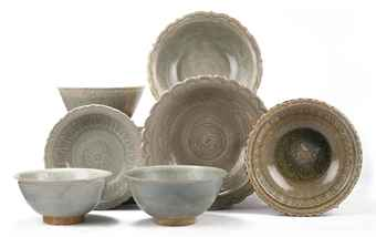 An assorted lot of Thai Sawankhalok celadon bowls and dishes