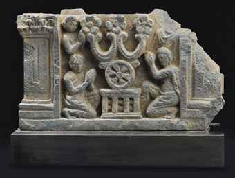 a_gray_schist_relief_of_the_triratna_adored_gandhara_2nd_3rd_century_d5416557h.jpg