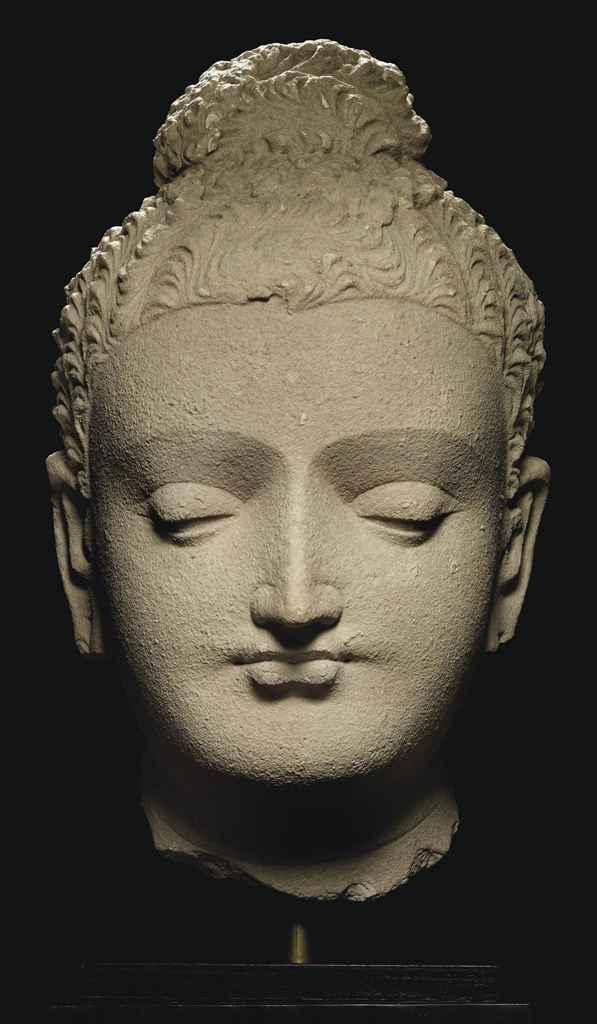 A large stucco head of Buddha , GANDHARA, 4TH/5TH CENTURY ...