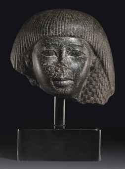 AN EGYPTIAN GRANITE HEAD OF AN OFFICIAL | NEW KINGDOM, LATE ...