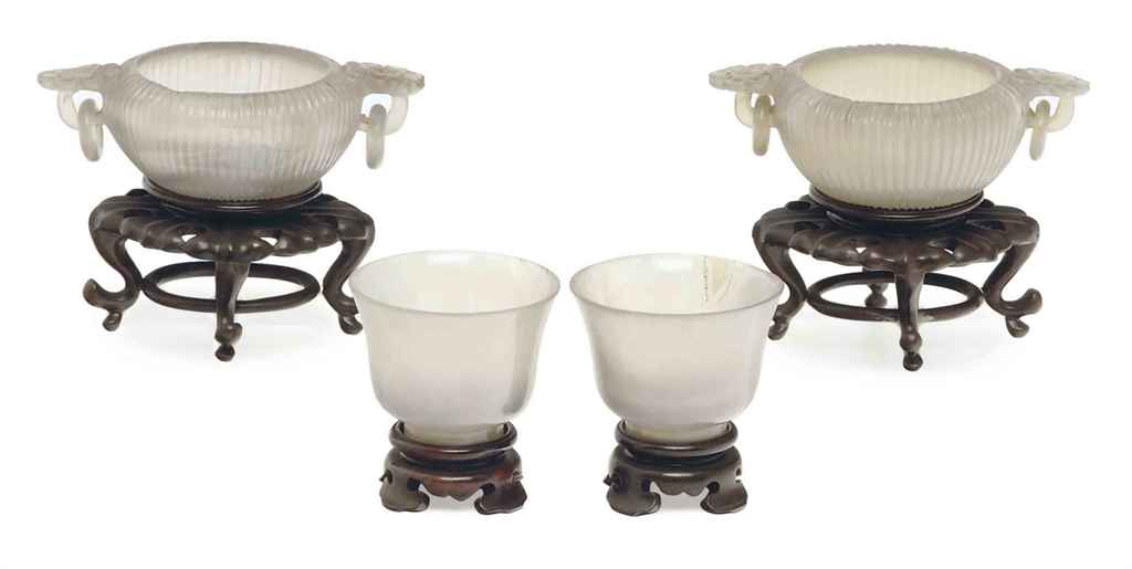 A PAIR OF CHINESE CARVED AGATE TWO-HANDLED BOWLS, AND A PAIR...