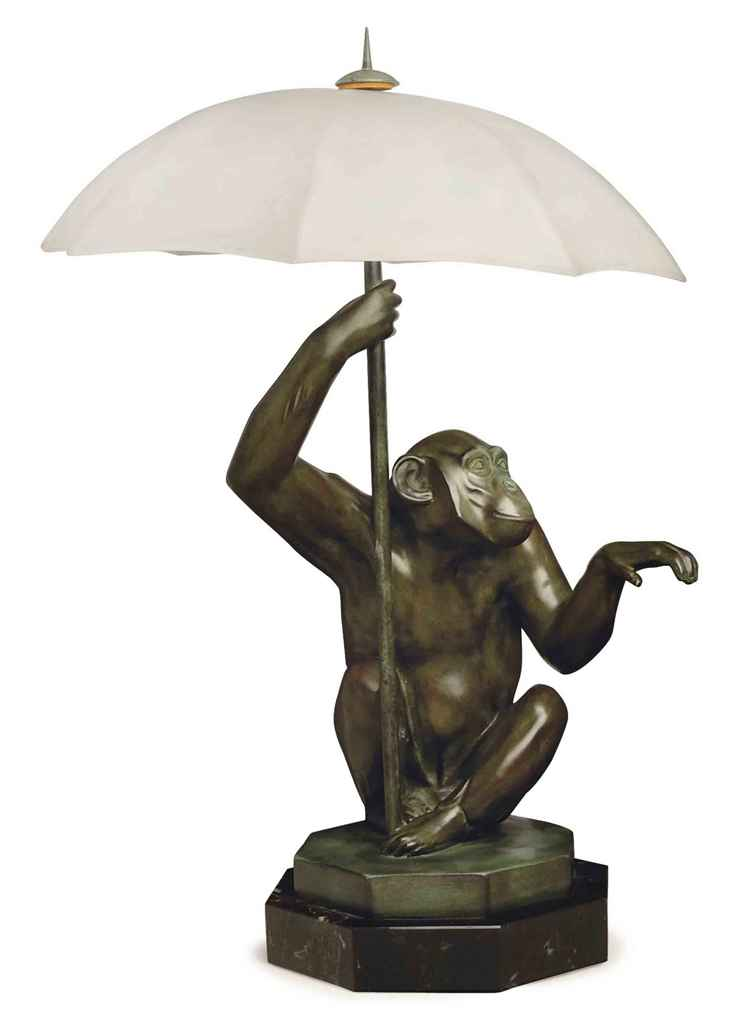 a french patinated bronze and frosted glass monkey figural. Black Bedroom Furniture Sets. Home Design Ideas