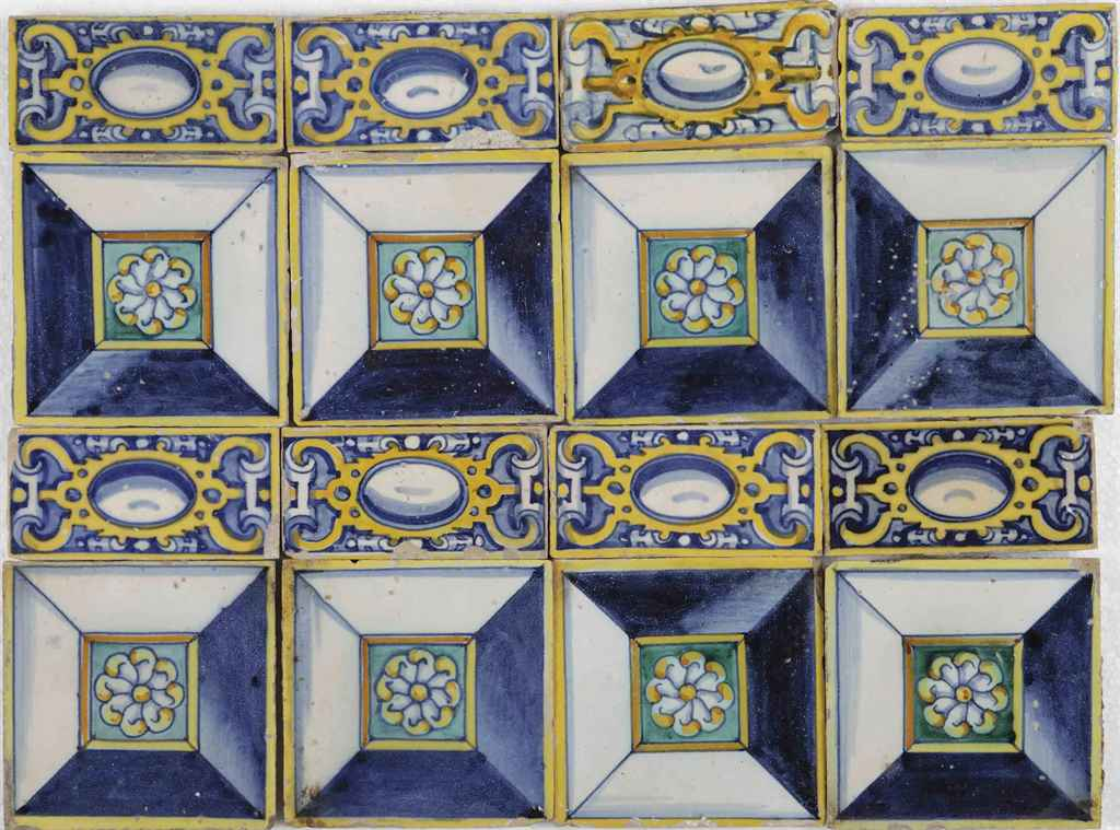 A set of eleven and a set of eight Spanish tiles