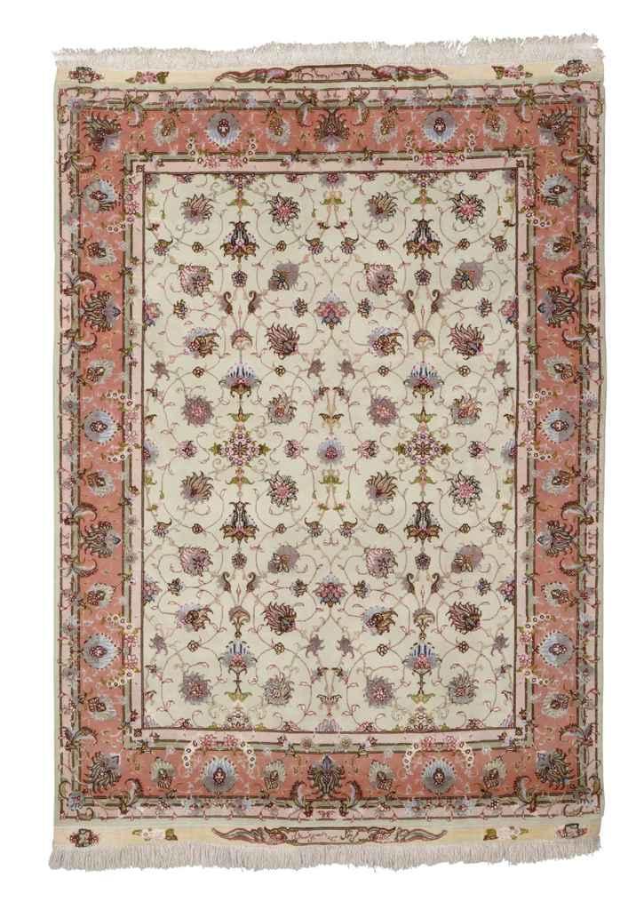 A very fine part silk Tabriz rug