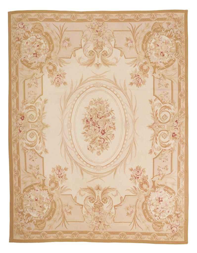 An Aubusson style carpet & Aub