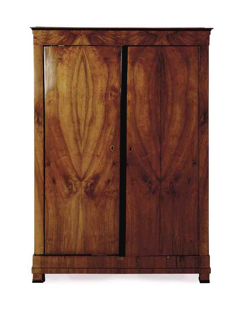 A BIEDERMEIER WALNUT ARMOIRE,