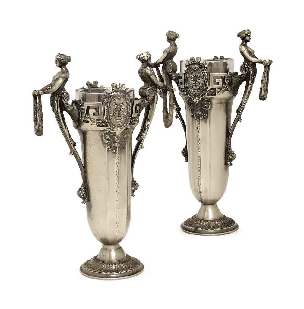 A PAIR OF SILVERED-METAL DOUBL