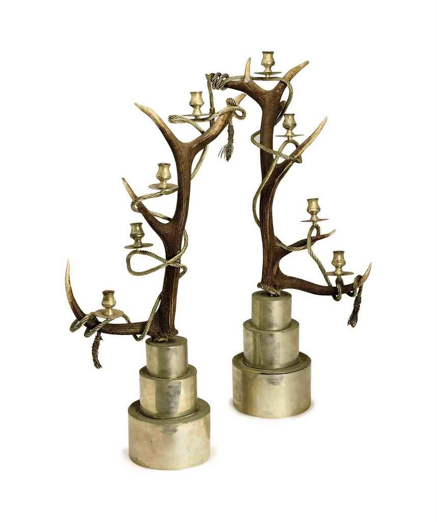 A PAIR OF HORN, PATINATED AND