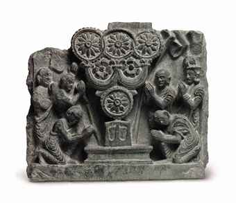 a_green_schist_relief_of_the_triratna_adored_gandhara_2nd_3rd_century_d5472974h.jpg