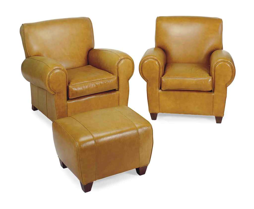A Pair Of Tan Leather Upholstered Club Chairs And Ottoman