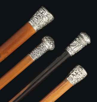 FOUR CHINESE SILVER TOP WALKING STICKS