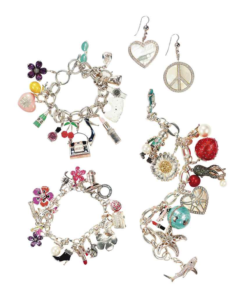 a group of silver charm bracelets and matching earrings. Black Bedroom Furniture Sets. Home Design Ideas