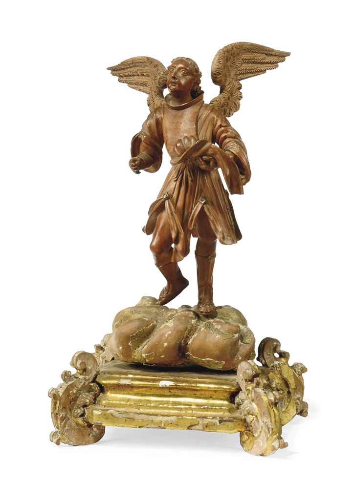 A GERMAN CARVED BOXWOOD FIGURE OF AN ANGEL
