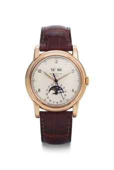 Patek Philippe.  A Fine And Very Rare 18k Pink Gold Perpetual Calendar Wristwatch With Moon Phases