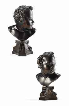 A BRONZE BUST OF A YOUNG BOY