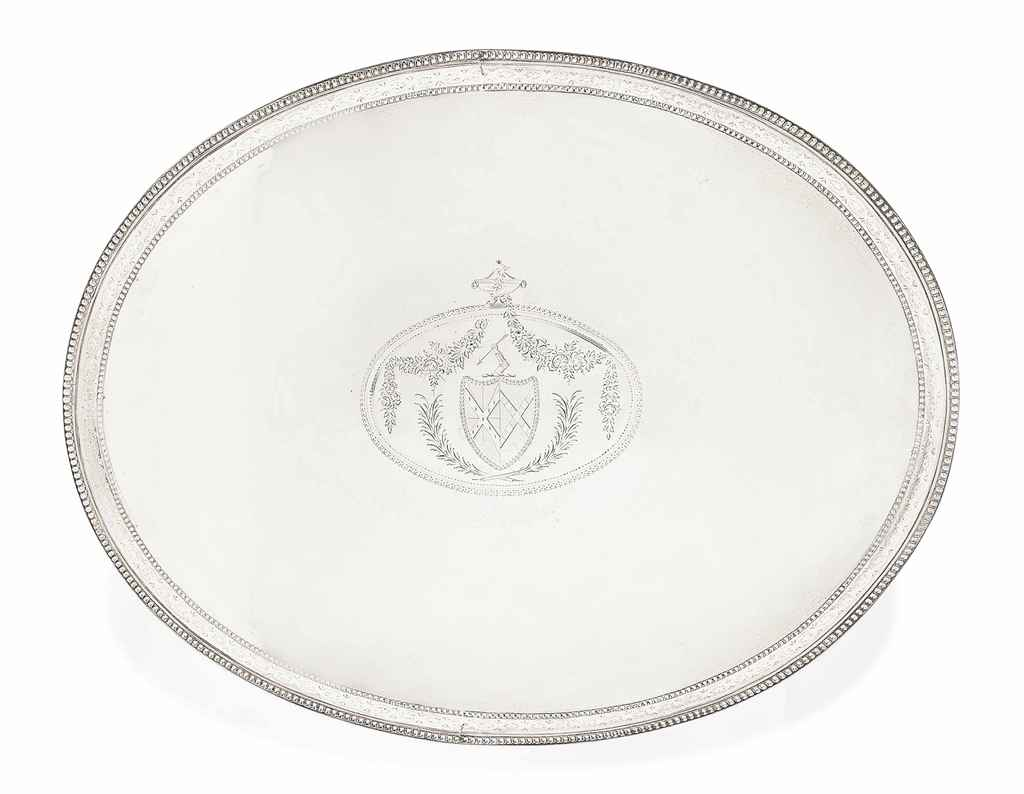 A GEORGE III LARGE OVAL SALVER OR TRAY