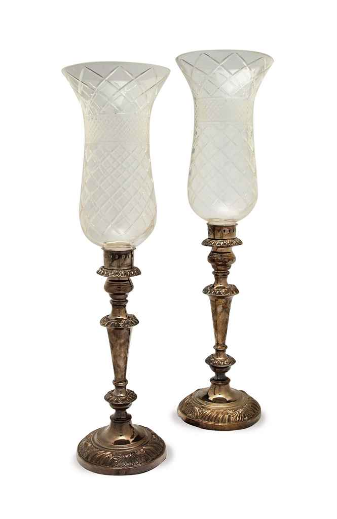 A PAIR OF REGENCY SHEFFIELD PLATED CANDLESTICKS AND A PAIR O...