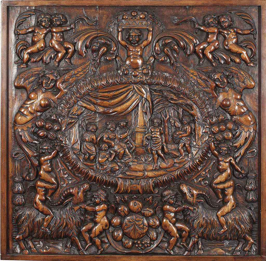 A PAIR OF WALNUT RELIEF PANELS
